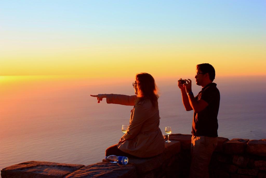Alla dessa fantastiska solnedgångar i Kapstaden